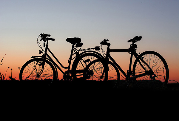 Mountain Bikes On a Hill Against a Sunset