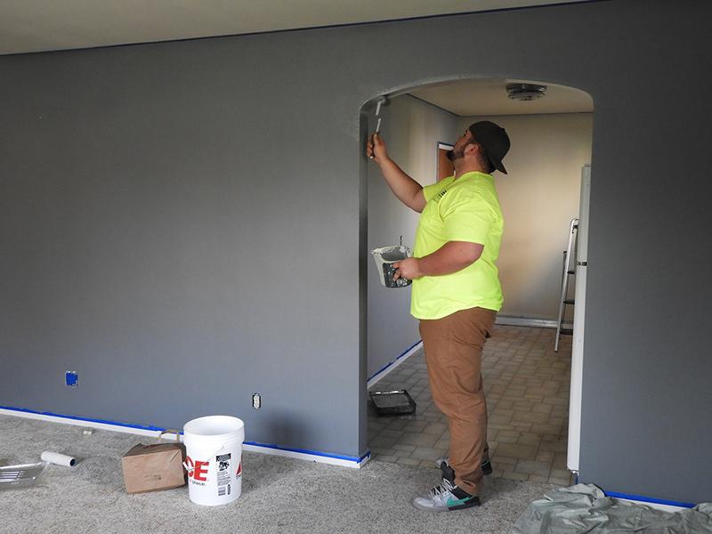 Man Painting a Doorway